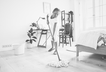 Young teen girl sweeping up from the floor