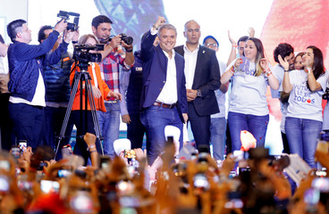 Presidential candidate Duque gestures to supporters after winning the presidential election in Bogota