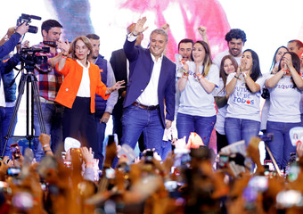 Presidential candidate Duque waves to supporters after winning the presidential election in Bogota