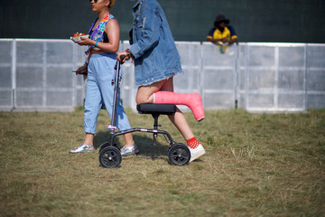 (C) Rae Armemdariz, 21, wheels herself to the main concert stage on the fourth and final day of the Firefly Music Festival in Dover, Delaware U.S.
