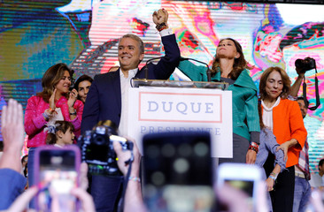 Presidential candidate Duque and his candidate for Vice President Ramirez celebrate after he won the presidential election in Bogota
