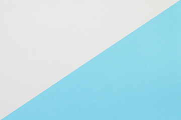 Two color paper with blue and white Overlap on the floor And split half of the image. background