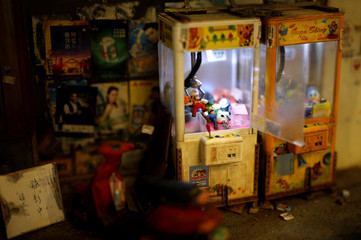 A miniature model of street scenes created by Taiwanese artist Hank Cheng, is seen at his workshop, in New Taipei City
