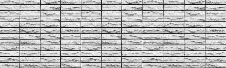 Panorama of Grey stone brick wall pattern and background