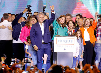 Presidential candidate Duque celebrates with his candidate for Vice President Ramirez after he won the presidential election in Bogota