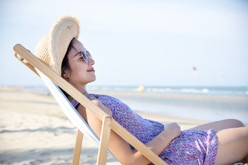 Woman chilling on the beach