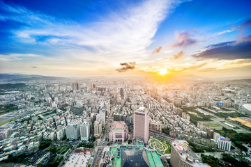 Wall Mural - Asia Business concept for real estate and corporate construction - panoramic urban city skyline aerial view under twilight sky and golden sun in Taipei, Taiwan