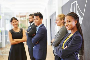 Start-up team standing proud