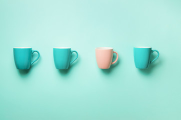 Pattern from blue and pink cups over turquoise background. Birthday party celebration, baby shower...