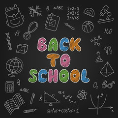 Back to school. Lettering. Chalkboard. Set of school elements in doodle and cartoon style