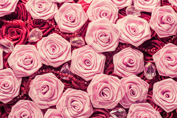 Wedding background with red and light pink silky roses, decoration of the wedding party