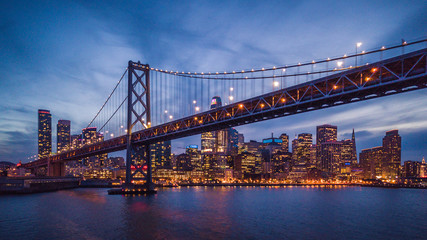 Fototapete - Cityscape view of San Francisco and the Bay Bridge at Night