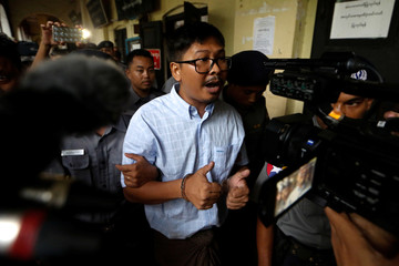 Detained Reuters journalist Wa Lone arrives for the court hearing in Yangon