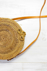 Fashionable handmade natural organic rattan bag on light background. Copy space, top view. Ecobags from Bali. Eco-bag concept.