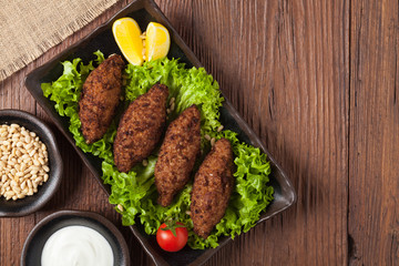 Traditional arabic kibbeh with lamb and pine nuts.