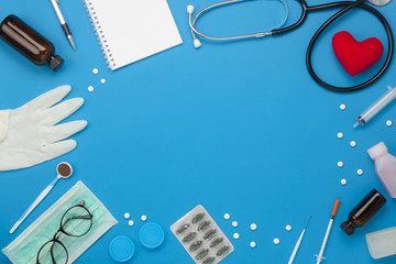 Flat lay aerial of accessories healthcare & medical background concept.Free space for mock up & template.Table top view objects on rustic blue paper.An idea for essential tools doctor in hospital.