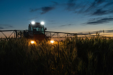 Machine for spraying pesticides and herbicides in the field at night.