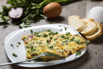 Omelet made from eggs, bacon, cheese and onion