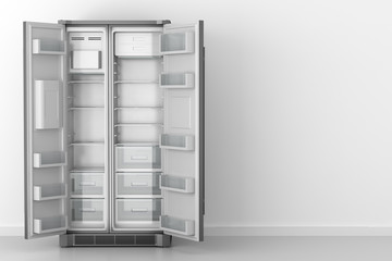 modern empty fridge in front of white wall
