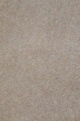 Gray concrete floor texture with small dash pattern. Close-up of scabrous background. Vertical orientation