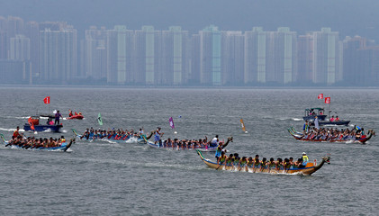 Participants compete during a race to mark Tung Ng or Dragon Boat Festival in Hong Kong