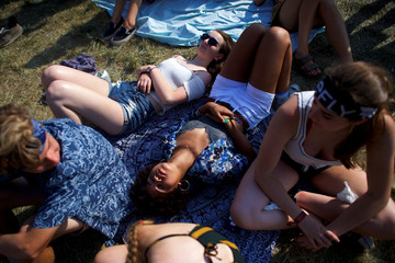 Revelers slumber on the fourth and final day of the Firefly Music Festival in Dover, Delaware U.S.