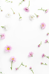 Floral pattern arranged on white background with empty space for text framed at the center