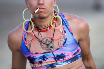 Irving Santos Julius smokes a cigarette on the fourth and final day of the Firefly Music Festival in Dover, Delaware U.S.