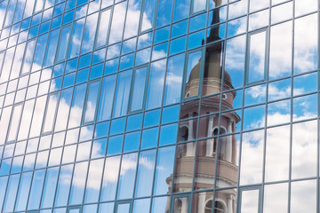 Modern building and an old Church reflection. Architectural features and ideas. Old and new parts. The city's skyline.