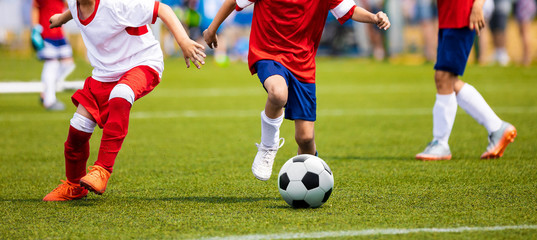Boys Kicking Soccer Match on Grass. Youth Football Game. Children Sport Competition. Kids Playing Outdoor
