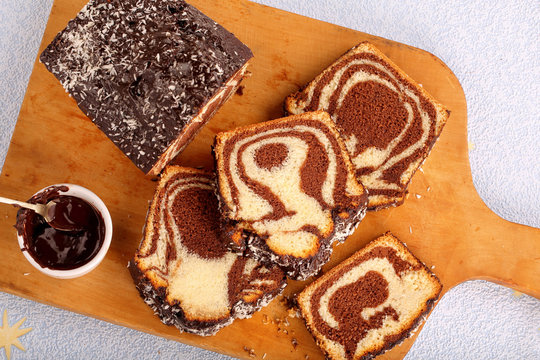 Swirl cake with chocolate on wooden board