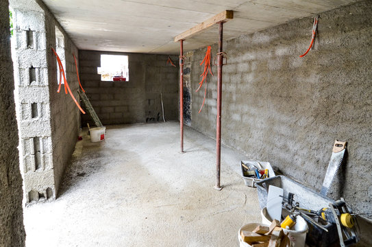 Plastering, rebuilding, waterproofing basement or a cellar and work tools.