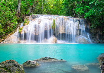 Wall Mural - Erawan waterfall in tropical forest in Thailand