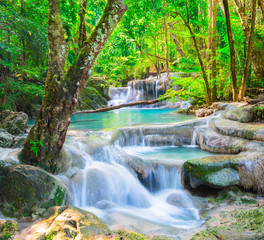 Tuinposter Watervallen Beautiful waterfall in deep forest