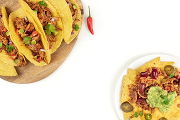 Mexican food with copy space, overhead photo of hot spicy tacos and nachos on white