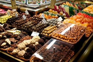 Famous sweet candy market .Confectionery at Boqueria market place in Barcelona, Spain. Assorted chocolate candy shop.