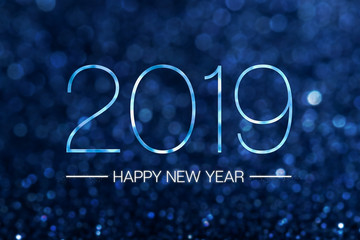 Happy new year 2019 with dark navy blue glitter bokeh light sparkling background,Holiday celebration festive greeting card.