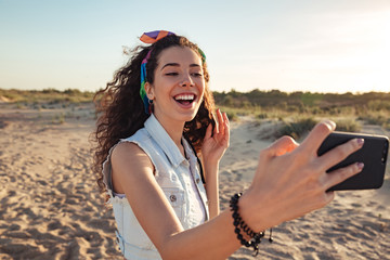 Cheerful young girl taking a selfie