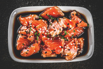 Salmon Sashimi in Marinade (Tamari, Sesame Oil, Lime Juice, and Honey) Topped with Black and White Sesame Seeds