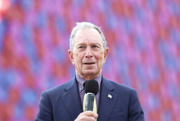 Michael Bloomberg speaks in front of Christo's work The London Mastaba, on the Serpentine in Hyde Park, London