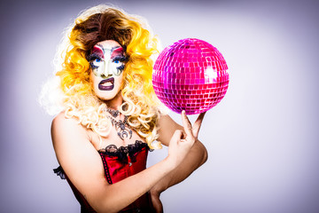 glamorous drag queen with disco ball