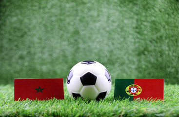 ball with Morocco VS Portugal flag match on Green grass football 2018