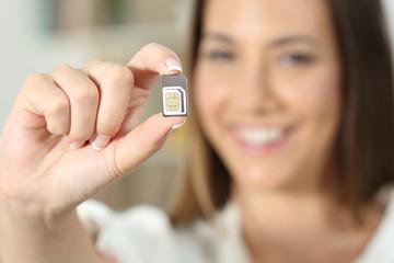 Happy woman hand holding a sim card