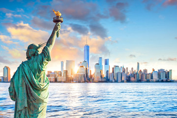 Statue Liberty and  New York city skyline at sunset Wall mural