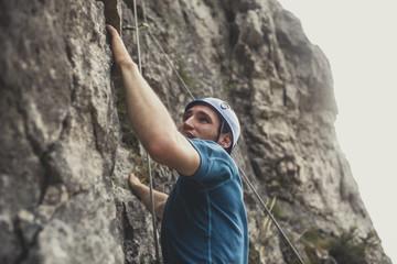 Mountaineer Climbing a Rock Wall mural