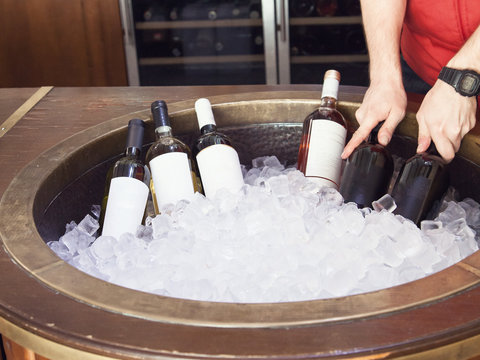 bottles of white red and pink wine in ice