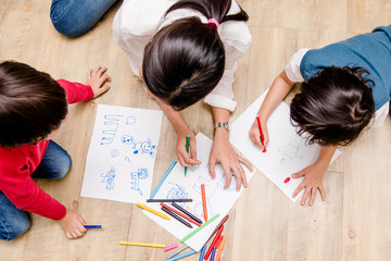 Top view Family happy children group kid boy and girl kindergarten paint drawing on peper teacher education