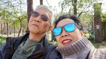 Asian senior couple sefie happy retirment trip to Europe