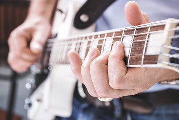 man playing guitar - close-up