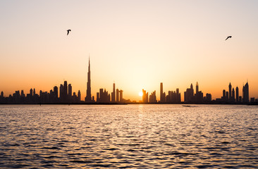 Panoramic view of Dubai cityscape at sunset